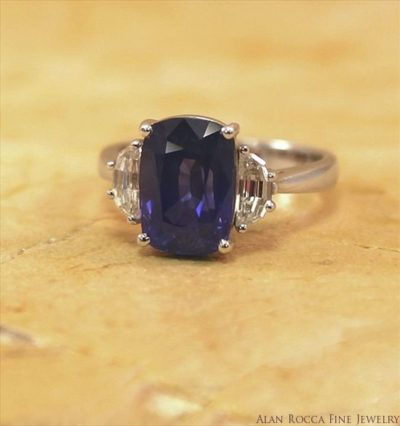 Cushion Shaped Blue Sapphire Classic Cocktail Ring with Trapezoid Diamond Side Stones