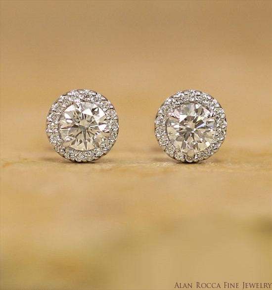 Brilliant Cut Diamond Post Earrings Surrounded by a Halo of Prong Set Round Diamonds