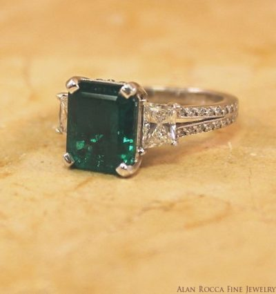 Radiant Cut Emerald with Trapezoid and Round Cut Diamonds