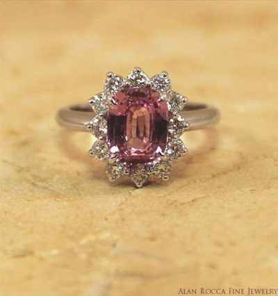 Cushion Shaped Pink Sapphire Classic Cocktail Ring with Halo of Prong Set Round Diamonds