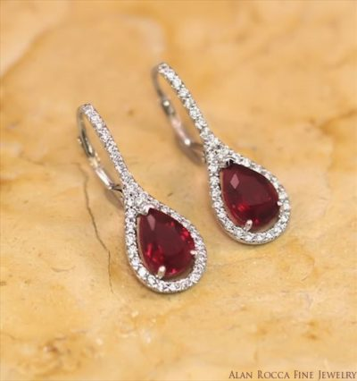 Pear Shaped Ruby Drop Earrings Surrounded by Prong Set Round Diamonds