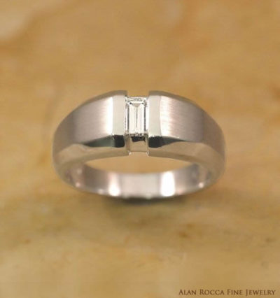 Tapering Dual Finish Band with Tension Set Emerald Cut Diamond