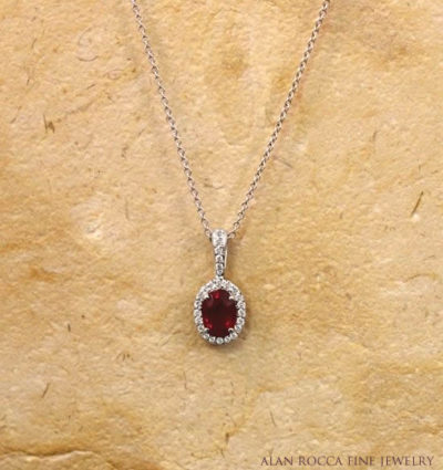 Oval Ruby Pendant with Prong Set Round Diamonds