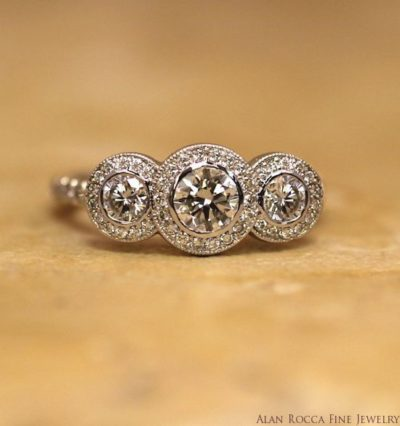 Bezel Set Brilliant Round Three Stone Diamond Ring