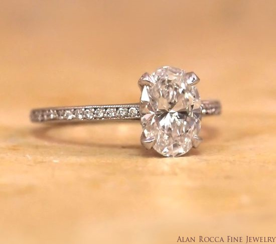 Oval Diamond Ring with Channel Set Round Diamonds