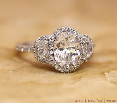 Oval and Half-Moon Three Stone Diamond Ring with Prong Set Halo